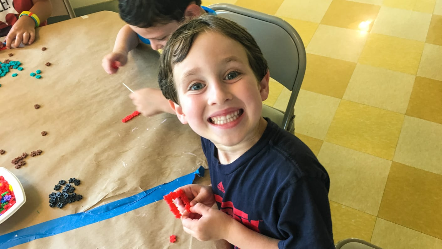 Young camper in arts & crafts activity