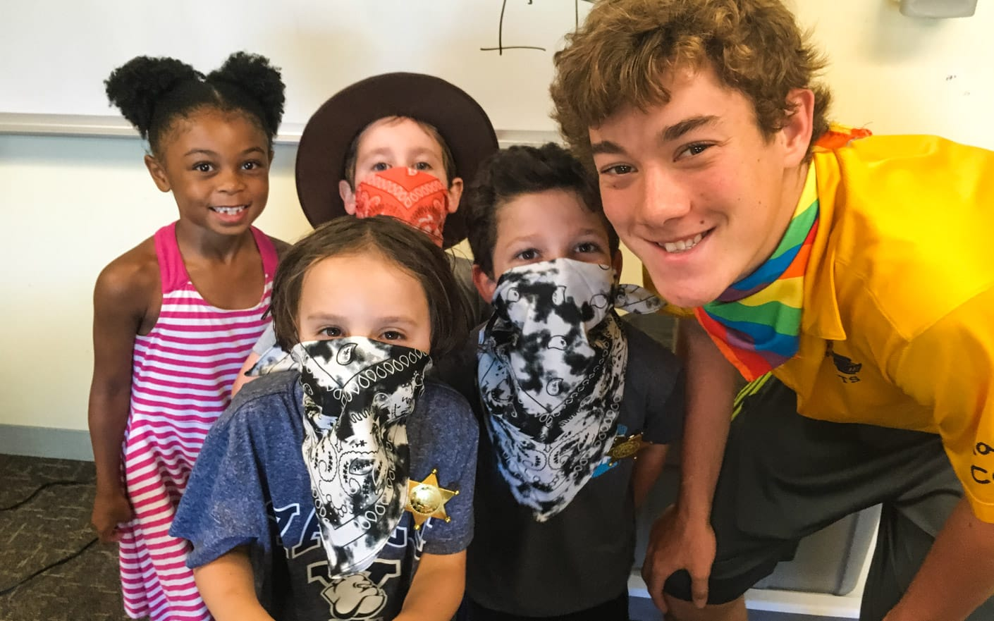 Staff and campers wearing masks