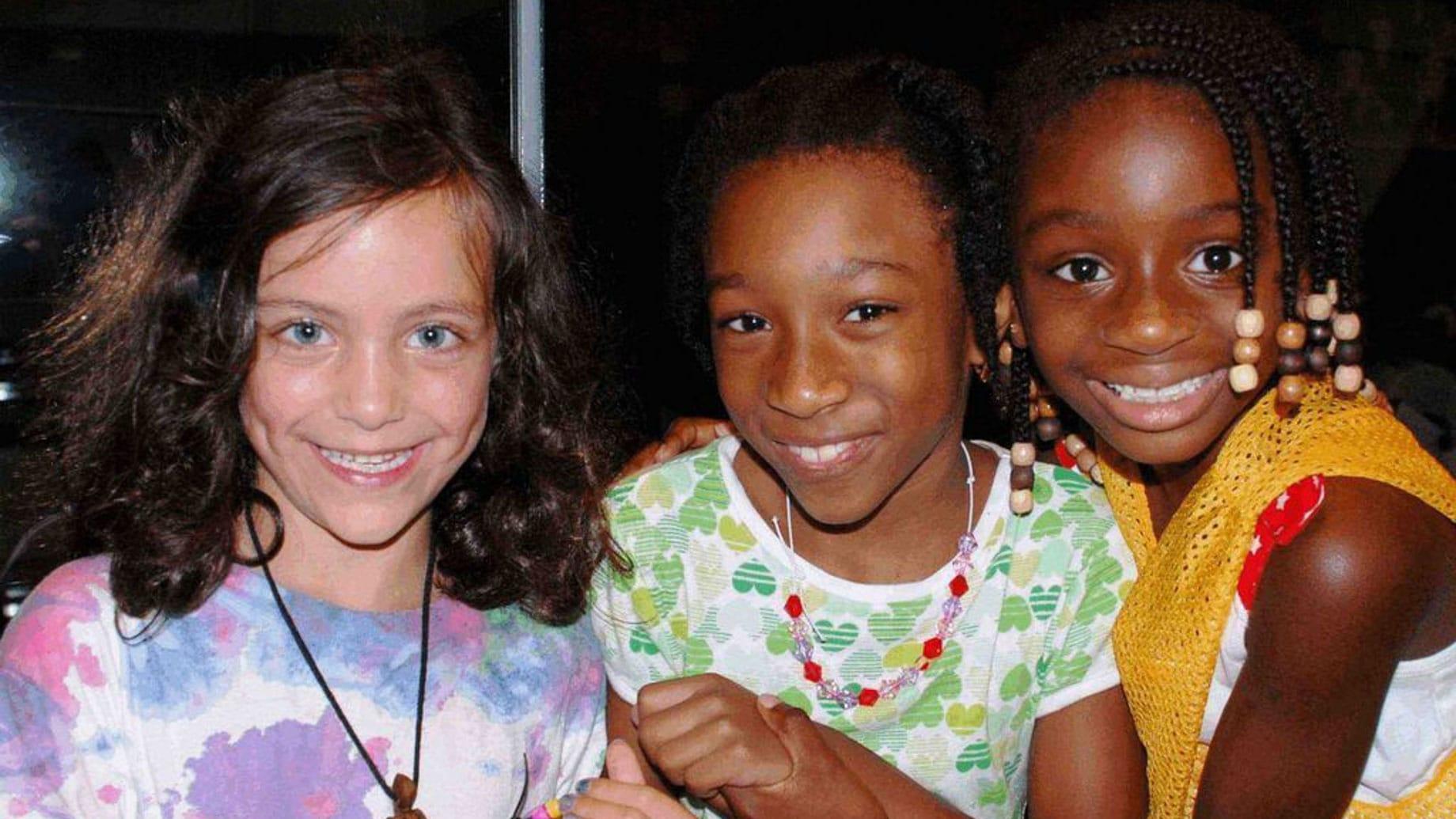 girls smiling at camp