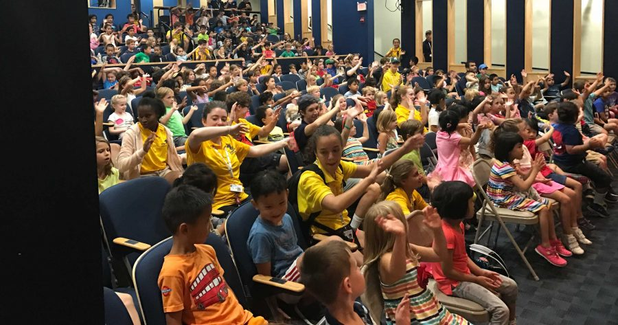 Campers at assembly watching a special performance