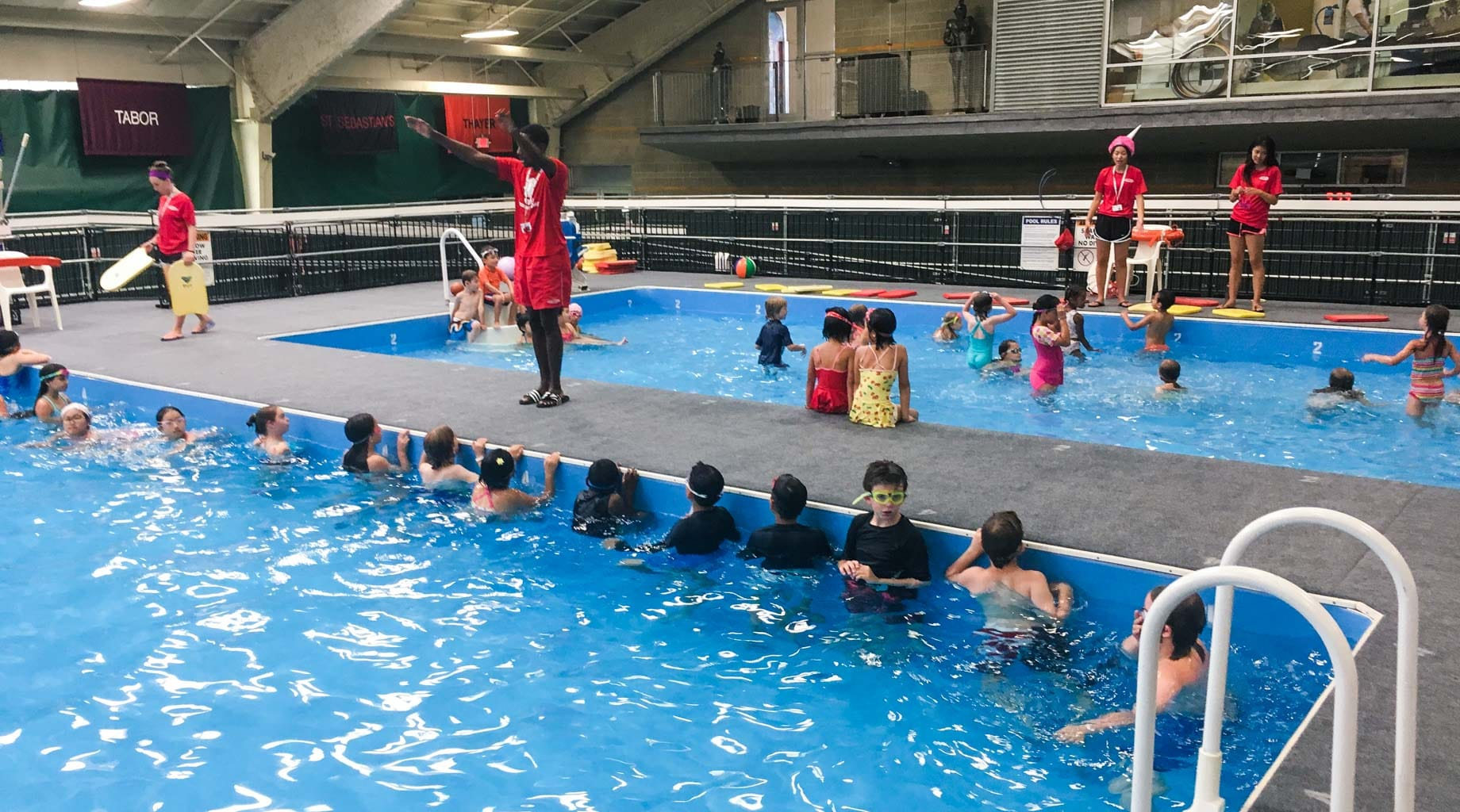 Lifeguards teaching campers how to swim