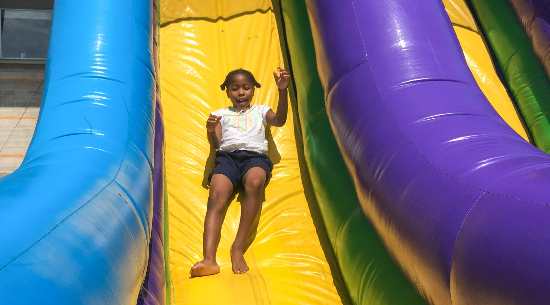 Girl going down inflatable slide