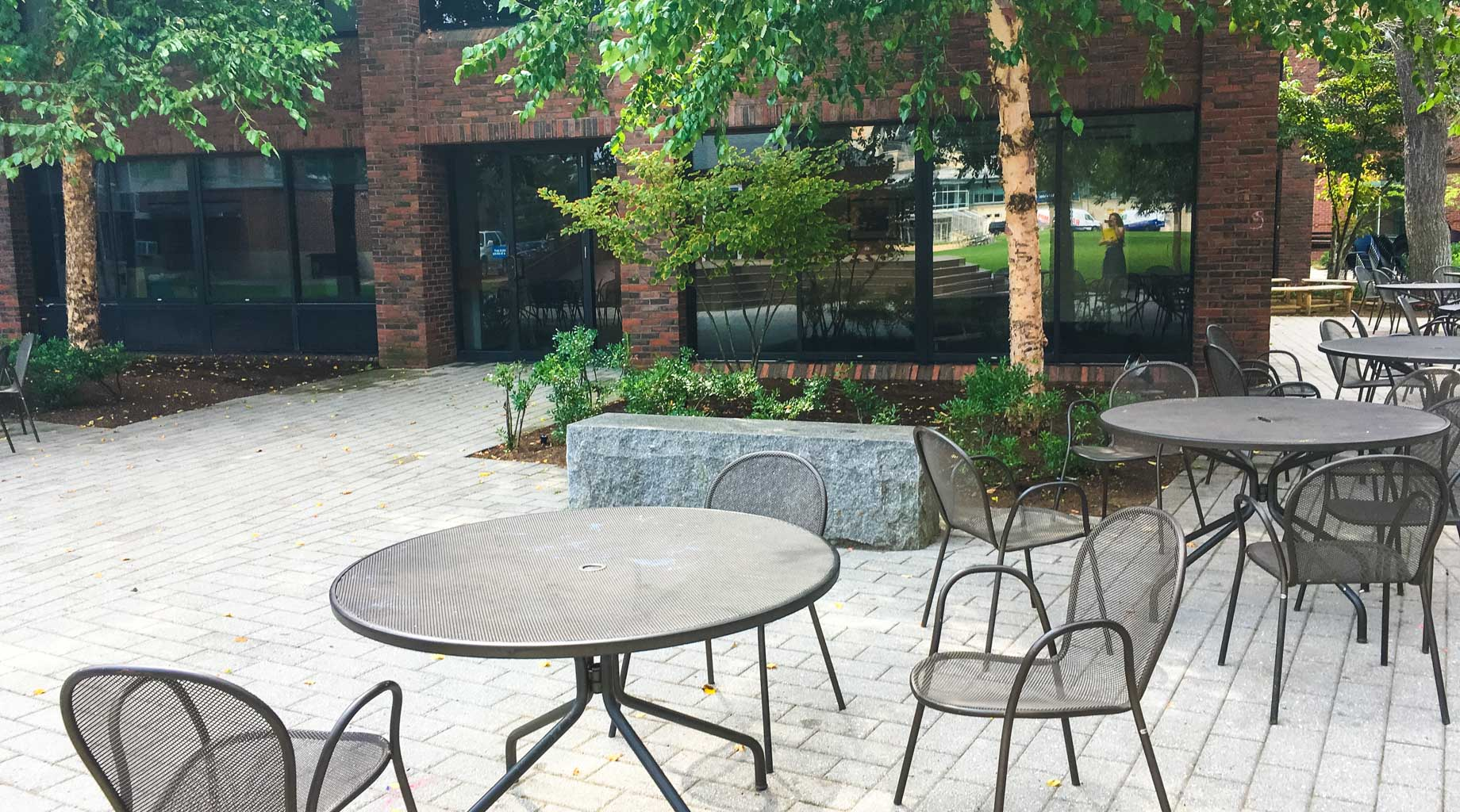 Tables and chairs in patio area