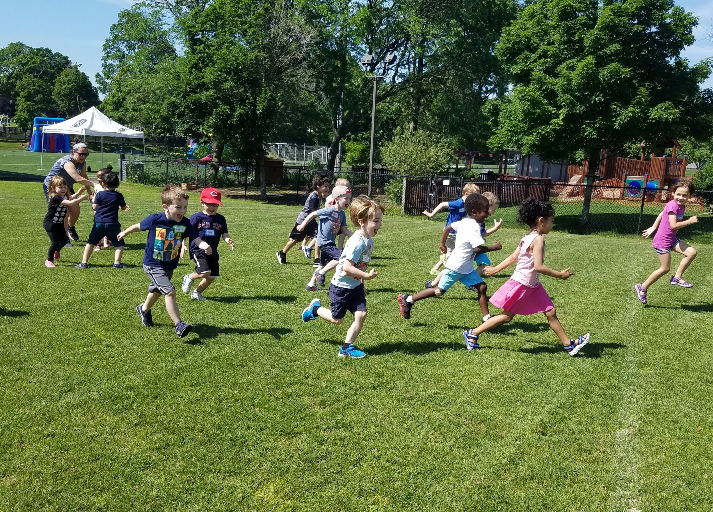 Children running accross a field